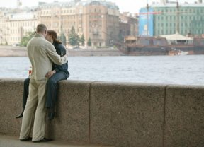 Couple kissing by the river