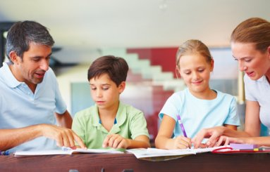 Family Parents assisting kids with homework
