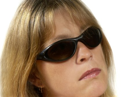 Woman serious with sunglasses